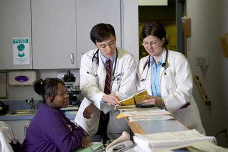 Twp physicians reviewing a medical chart