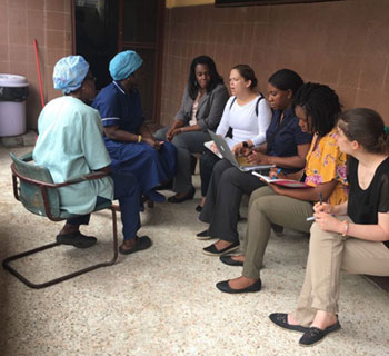 Deborah Olumuyiwa speaking with group at St. Joseph's Catholic Hospital