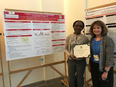 Student receives certificate from Dr. Beth Barnet for poster presentation at Primary Care Day.