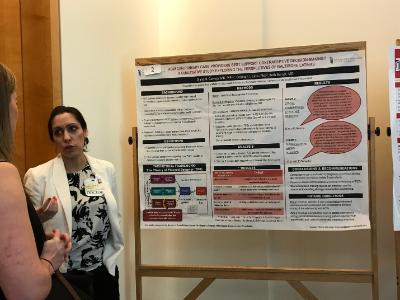 Dr. Diana Carvajal discusses her poster at Primary Care Day.