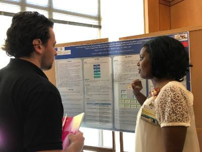 Dr. Weyinshet Gossa presents her poster at Primary Care Day.
