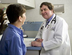 Dr. Colgan consulting with a patient