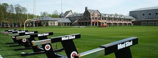 Football sleds on practice field