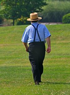 Amish man walking in field