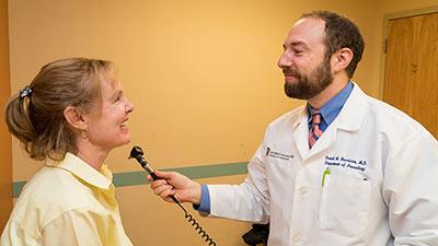 Daniel Harrison, MD With Patient