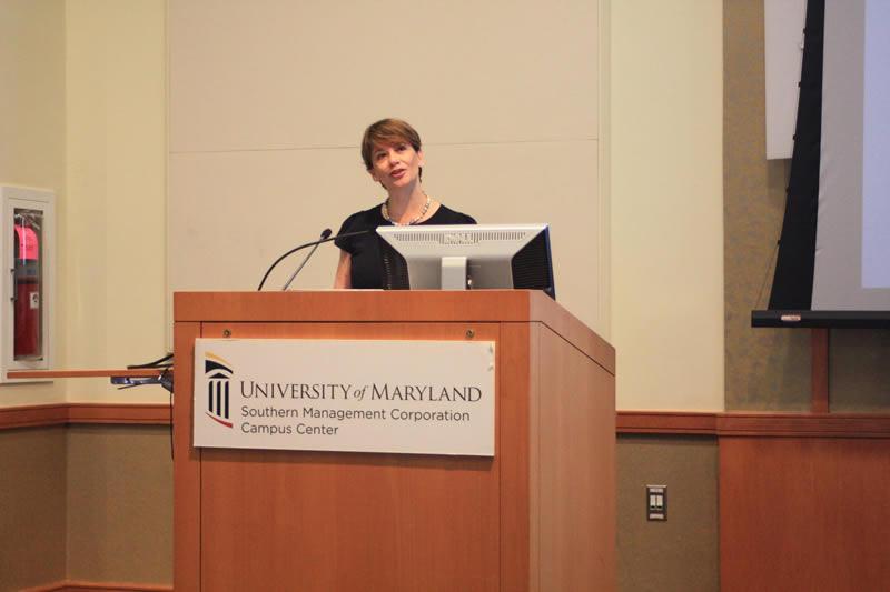 Dr. Shifa Turan speaking at Symposium