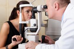 Female having eyes examined