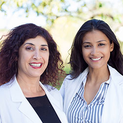 Two female doctors smiling