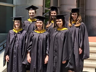 2015 graduates outside of building