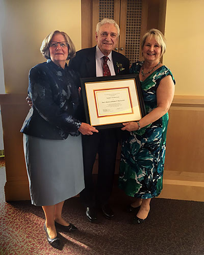 Dr. Blaustein's wife, Ellen Blaustein, with Dr. Blaustein and M.J. Tooey, the executive director of the HSHSL