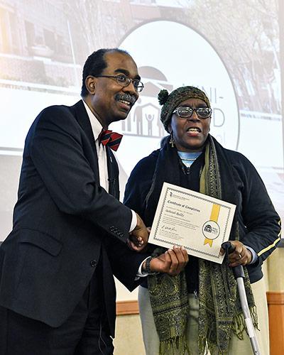 Dean Reece congratulating a Mini-Med School graduate