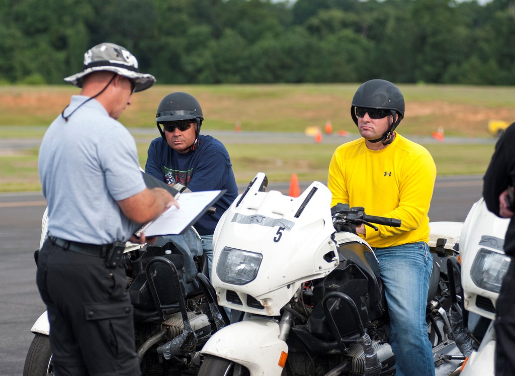 Investigator surveying motorcyclists on sport bikes