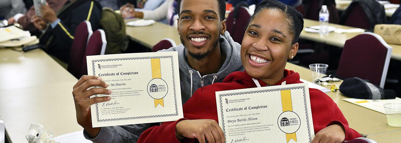 Photo of recent Mini-Med School graduates