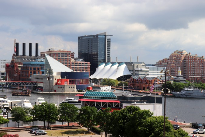 Baltimore skyline including the National Aquarium, Rusty Scupper, Legg Mason building, various boats in the Inner Harbor.